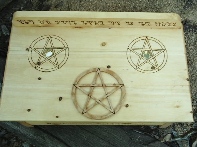 Three Pentacles and symbols for the god and goddess on this Wiccan Altar